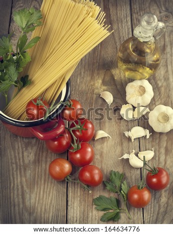 Italian Pasta with tomatoes, garlic, olive oil and italian parsley - stock photo