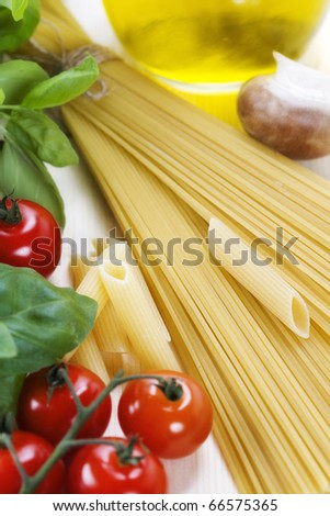 Italian Pasta with tomatoes, mushrooms, olive oil and basil on a white background - stock photo