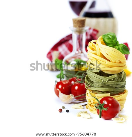 Italian Pasta ( with tomatoes,  olive oil and basil) and wine on a white background - stock photo