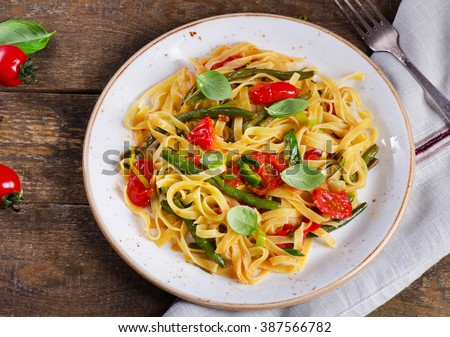 Italian pasta with vegetables on  wooden background. Top view