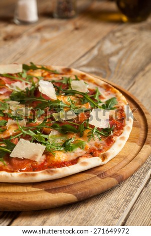 "Italian pizza ""Parma""  lies on beautiful wooden table.  - stock photo"