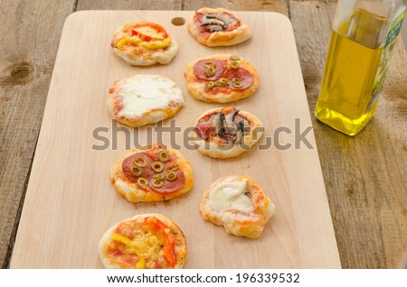 Italian pizza with paprika, salami and olives, home made - stock photo