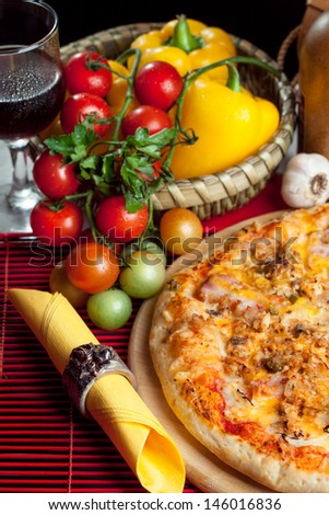 Italian pizza with tomato and pepper - stock photo