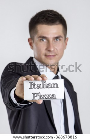 Italian Pizza - Young businessman holding a white card with text - vertical image