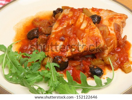 Italian poached tuna steaks in tomato and white wine sauce.