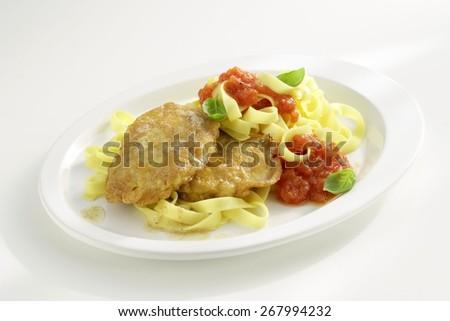 Italian Pork Escalopes battered with Parmesan, Pasta and Tomato Sauce - stock photo