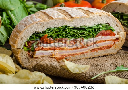 Italian Pressed Sandwich - full of tasty. Italian ham and cheese, spinach, homemade chips side dish