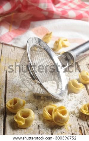 italian raw pasta tortellini for food recipe - stock photo