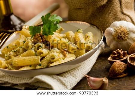 Italian regional dish made of pasta with walnut pesto on wooden table - stock photo