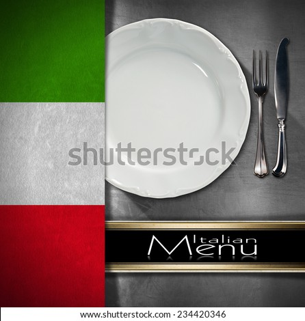Italian Restaurant Menu Design / Metallic background with textile italian flag, empty white plate with silver cutlery, fork and knife and black horizontal band. Template for food Italian menu - stock photo