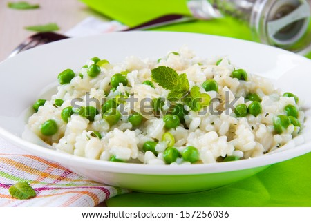 Italian risotto with rice, green peas, mint and cheese, restaurant dish