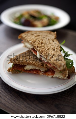 Italian salami and sheep cheese sandwich with brown bread.