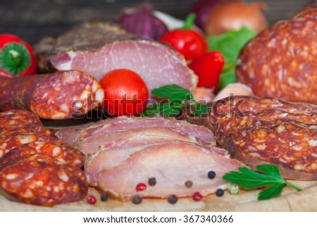 Italian salami meat platter - prosciutto ham, salami and sausage - stock photo