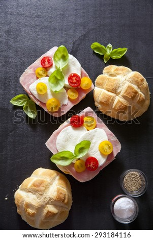 italian sandwich with ham, Multicolored cherry tomatoes, basil. space for writing text - stock photo