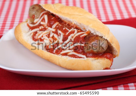 Italian sausage on a bun with tomato sauce and cheese - stock photo