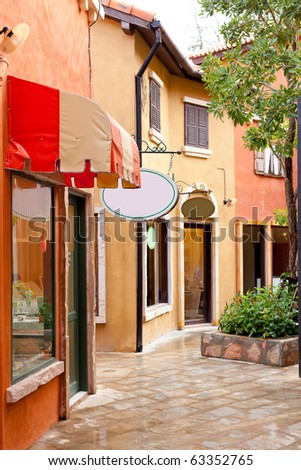 Italian shop building alley - stock photo