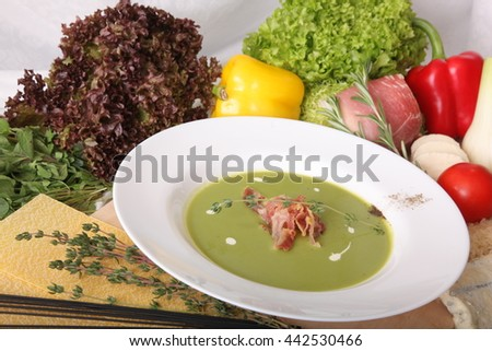 Italian soup with Bacon and vegetables on wooden board - stock photo