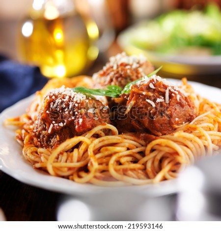 italian spaghetti and meatballs with salad in background - stock photo