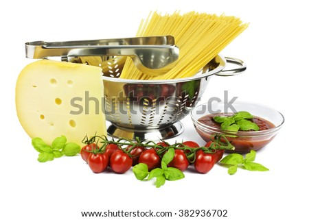Italian spaghetti in colander with tomato and cheese, isolated on white - stock photo