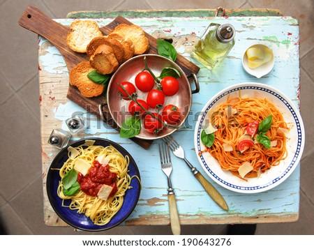 Italian spaghetti pasta dish bruschett���¡val, tomatoes and parmesan cheese - top view - stock photo