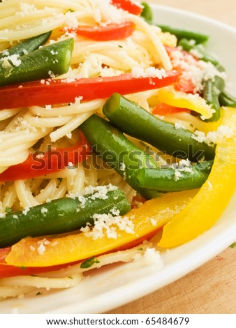 Italian spaghetti with peppers and green beans. Shallow dof.