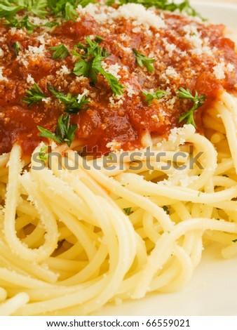 Italian spaghetti with tomato sauce and parmesan. Shallow dof. - stock photo