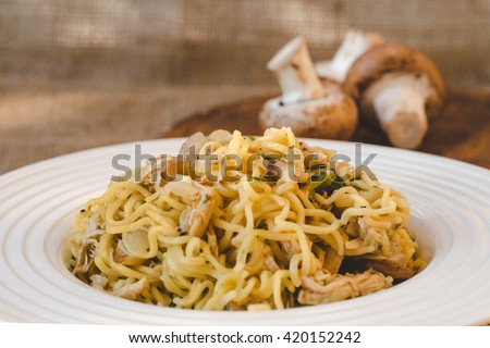 Italian specialty pasta with mushrooms - pasta con funghi close up, selective focus