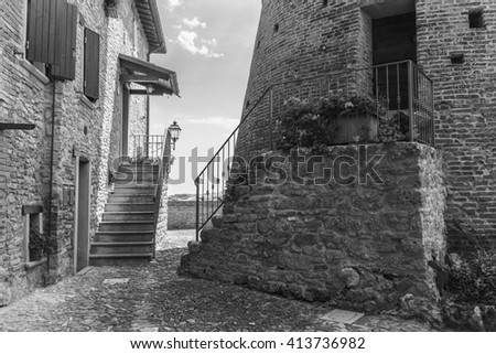 Italian street in a small provincial town in Tuscany, Italy. Black and white photography.