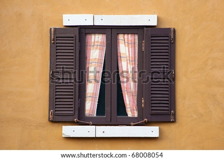 Italian style wood window - stock photo