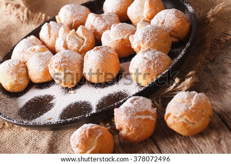 Italian sweet donuts Castagnole close-up on the table. horizontal, rustic