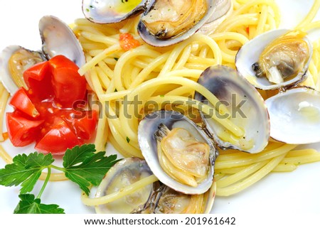 italian traditional food composed by spaghetti pasta and seafood  clams - stock photo