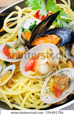 italian traditional food composed by spaghetti pasta and seafood fasolari,clams and mussels - stock photo
