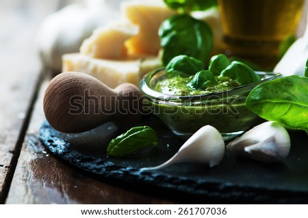 Italian traditional pesto with basil, chesse and oil, selective focus - stock photo