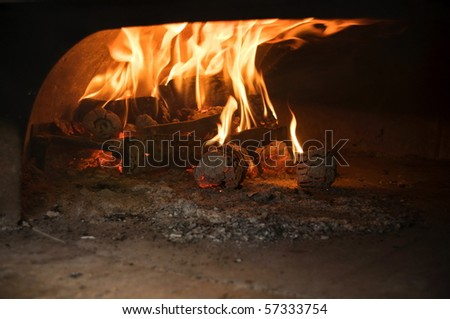 Italian traditional pizza  wood oven , fire detail - stock photo