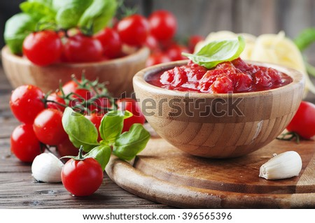 Italian traditional sauce with tomato and basil, selective focus - stock photo