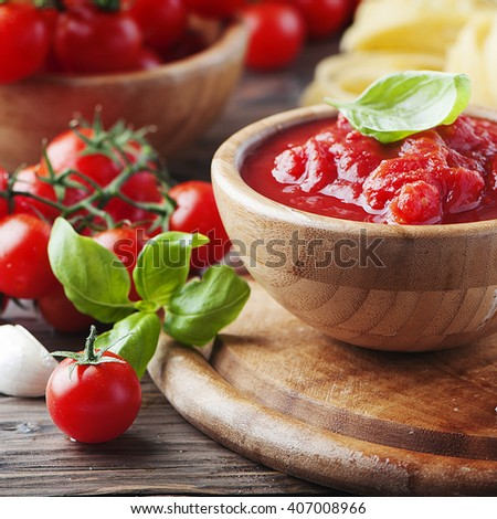 Italian traditional sauce with tomato and basil, selective focus and square image - stock photo