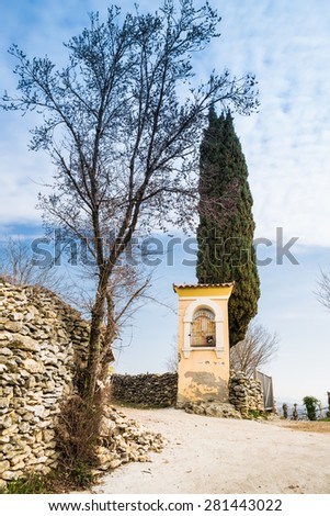 Italian traditional votive temple in the countryside to propitiate the harvest - stock photo