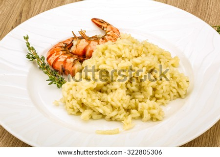 Italian trditional Risotto with tiger prawn and thyme