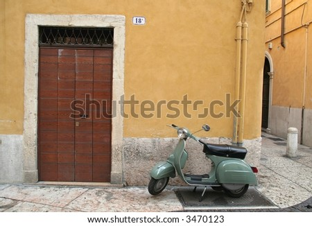 Italian typical street whit door and a scooter - stock photo