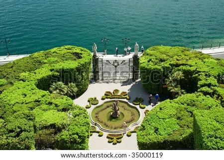 italian villa's garden by the lake - stock photo