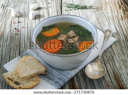 Italian Wedding Soup with Meatballs on Rustic Wood Background - stock photo