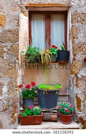 Italian Window Decorated with Fresh Flowers - stock photo