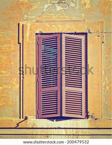 Italian Window with Closed Wooden Shutters in  Rome, Instagram Effect - stock photo