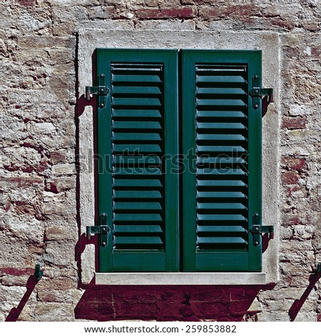 Italian Window with Closed Wooden Shutters, Vintage Style Toned Picture - stock photo