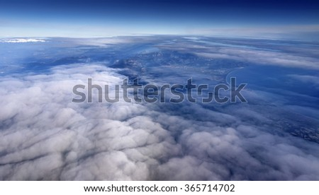 Italy, aerial view of clouds in the sky and Tyrrhenian coastline