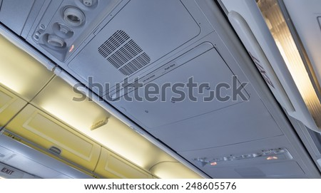 Italy, airplane cabin, emergency exit light - stock photo