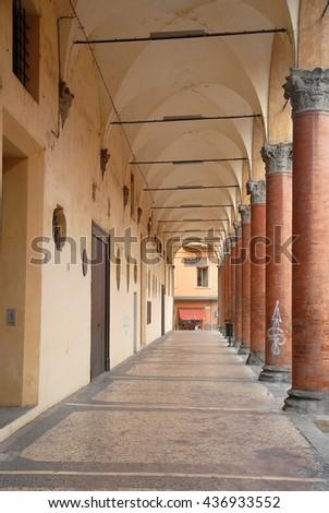 Italy, Bologna old portico in Azeglio street. - stock photo