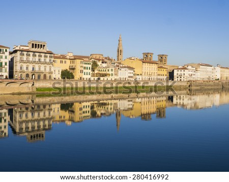 Italy, buildings of Florence reflected in the water of Arno river