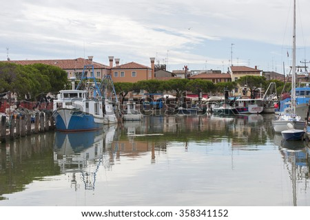ITALY, Caorle - JULY 11, 2014: Tourist and fishing port in the city. - stock photo
