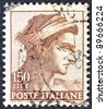 "ITALY - CIRCA 1961: A stamp printed in Italy from ""Michelangelo"" issue shows a head of the ""Ignudi"" from Sistine Chapel, circa 1961. - stock photo"